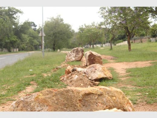 The rocks on the pavements of Ward 126 will prevent motorists from driving on the pavement.