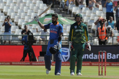 India's Virat Kohli (L) celebrates his century during the One Day International (ODI) cricket match between India and South Africa, at Newland Stadium, on February 7, 2018, in Cape Town.  / AFP PHOTO / RODGER BOSCH