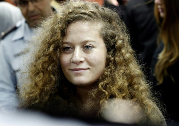 Seventeen-year-old Palestinian Ahed Tamimi, a well-known campaigner against Israel's occupation, arrives for the beginning of her trial at the Israeli military court at Ofer military prison in the West Bank village of Betunia on February 13, 2018