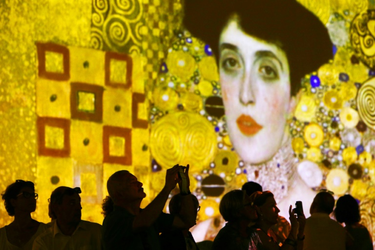 """Austrian artist Gustav Klimt was known for his golden paintings of women, including his """"Portrait of Adele Bloch-Bauer"""", on display last year at Milan's Mudec museum"""