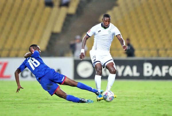 Ayanda Gcaba of Platinum Stars tackled by Siyabonga Nhlapo of Supersport United during the Absa Premiership 2017/18 match between Platinum Stars and SuperSport United at Royal Bafokeng Stadium. (Samuel Shivambu/BackpagePix)