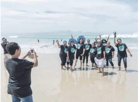 SAY CHEESE. Members of the Mitchell's Plain community pose for a photo on the beach beside the Monwabisi Desalination Plant in Cape Town. Picture: Yeshiel Panchia