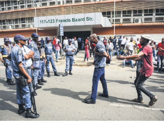 EFF Student Command members argue with police outside the department of higher education and training in Pretoria yesterday. They are protesting because they are unable to register at higher institutions of learning due to historical debt. Picture: Jacques Nelles