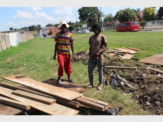 Mothomong Molutsi and Ramosoeu Ramosoeu moving the materials into the squatter camp.