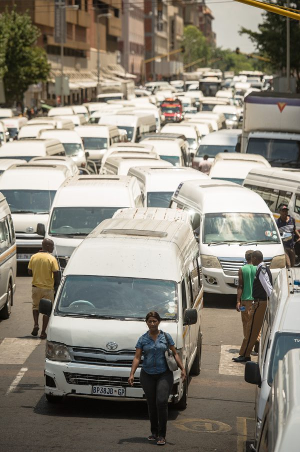 Pedestrians are seen making their way through the taxis blocking the roads in Pretoria CBD by protesting Taxi drivers and commuters from Hammanskraal during their march to Tshwane House to hand over a memorandum demanding that taxi's should be allowed to drive to the CBD, 5 February 2018, Pretoria. Picture: Jacques Nelles