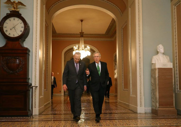 Democratic Senate Minority Leader Charles Schumer (L) and Republican Senate Majority Leader Mitch McConnell had struck a bipartisan budget deal, but were unable to avert a US government shutdown