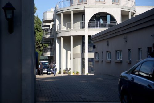 The Hawks are pictured outside the Gupta compound in Saxonwold,14 February 2018.  The Hawks raided the residence as part of the unit's investigation into state capture.  Picture: Tracy Lee Stark