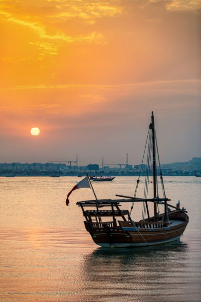 Dhow boat at the coast of Doha during sunset