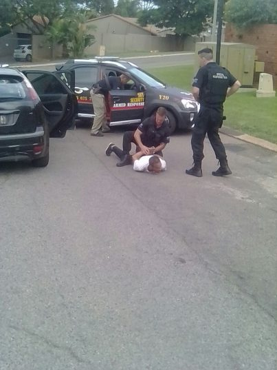 One of the suspects is apprehended by SRT Security. Image supplied