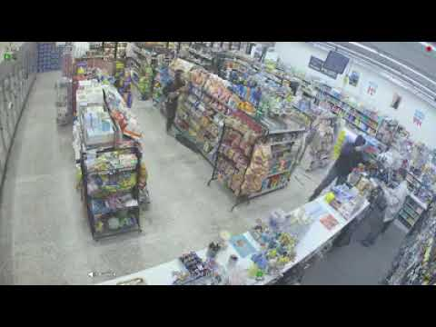 WATCH: Clever shoplifters take out armed robber with shotgun, save cashier