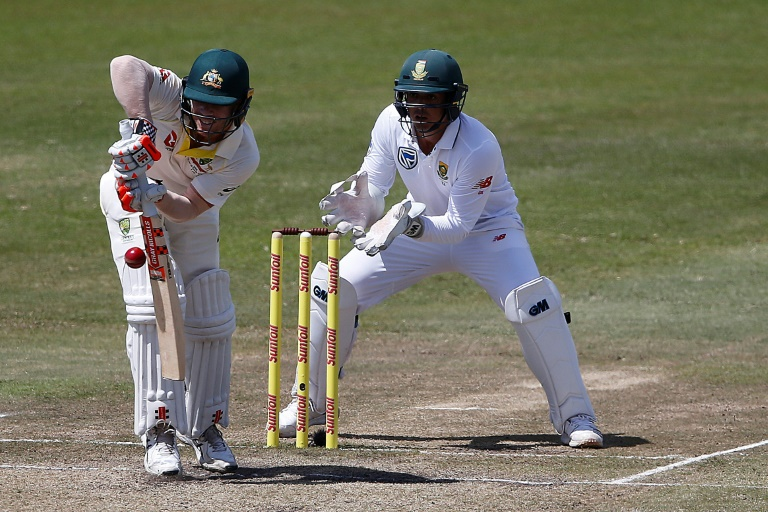 David Warner (left) and Quinton de Kock in action during play on the third day of the first Test in Durban