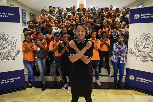 Yugen Blakrok, the South African musician that worked on the Black Panther soundtrack poses for a photograph along with pupils at the Brooklyn Ster Kinekor in Pretoria on 21 March 2018.. Picture: Jacques Nelles