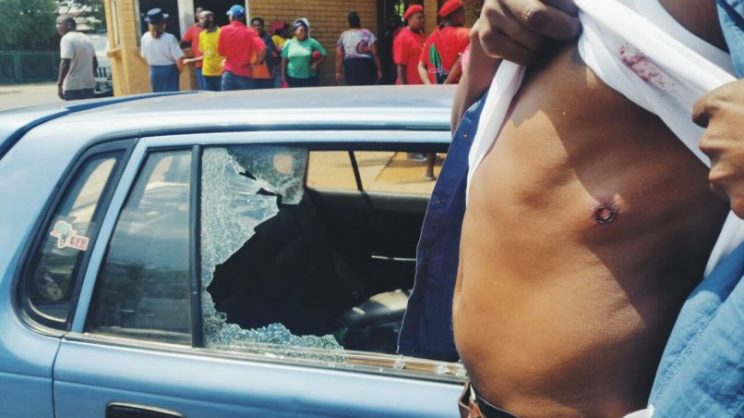 One of the people who were injured when police fired rubber bullets when chaos broke out at the Bronkhorstspruit Magistrate's Court where two farmers accused of assaulting a little black girl were granted bail in November last year. Picture: Rorisang Kgosana