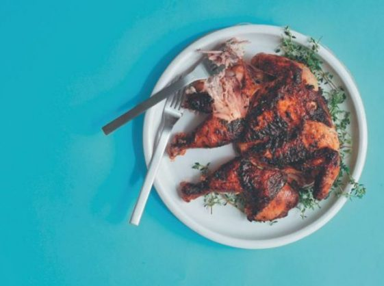 Spatchcock chicken marinated in yoghurt and spices. Photo: Dylan Swart