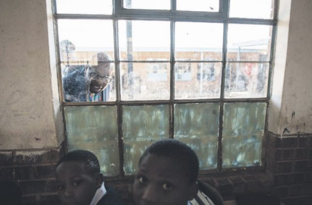 DA Gauteng shadow MEC for education Khume Ramulifho peeks through a broken window during an oversight visit to Phuthaditshaba Primary School in Atteridgeville, Pretoria. Picture: Jacques Nelles