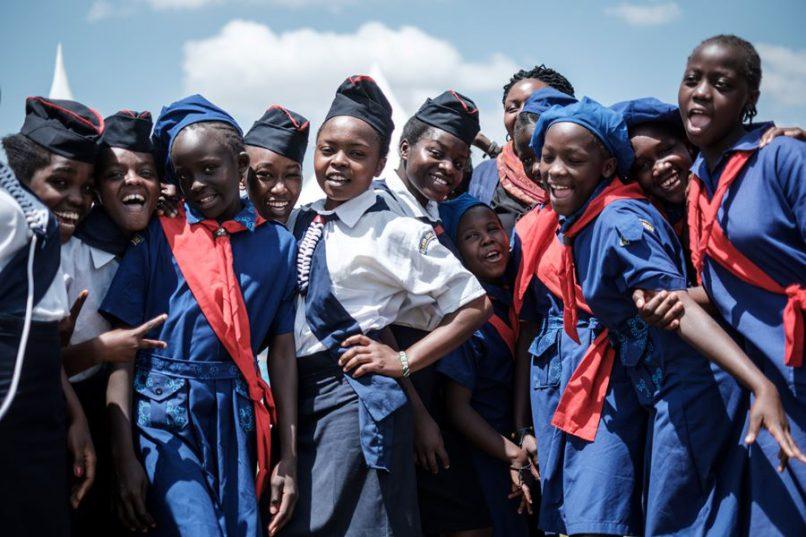 Members of Kenya Girl Guides take photos after attending International Women's day celebrations at Kawangware in Nairobi, Kenya, on March 8, 2018. Picture: AFP PHOTO / Yasuyoshi CHIBA