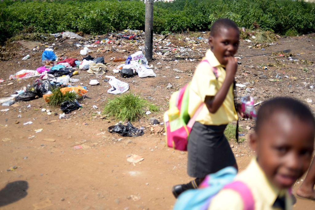 Children grow up in a garbage strewn neighbourhood in Kliptown. Picture: Tracy Lee Stark