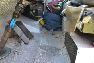 The stones used to smash the windows lie next to the foot pedals inside the truck Photo by Muzi Zincume