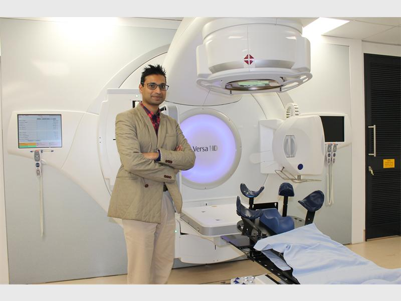 Director of the radiation practice at Sandton Oncology Dr Sudeshen Naidoo shows off the high-tech Elekta Versa HD machine used for advanced radiotherapy. Photo: Sarah Koning
