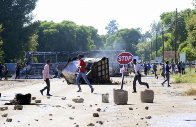 Looting and rioting during community protests calling for North West premier Supra Mahumapelo to step down on April 18, 2018 in Mahikeng, South Africa. The revolt against Mahumapelo has resulted in the looting of shops and trucks being torched in the area. Picture: Gallo Images