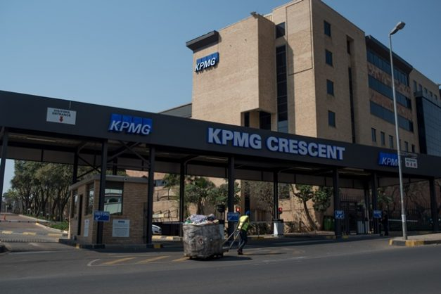 A recycler drags his trolley past the KPMG offices on Empire Road in Johannesburg on 15 September 2017. Picture: Yeshiel Panchia