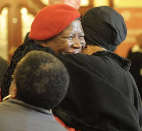 FILE: EFF leader Julius Malema is greeted by Winnie Mandela during registration ahead of the opening of parliament in Cape Town, 20 May 2014. Picture: Refilwe Modise