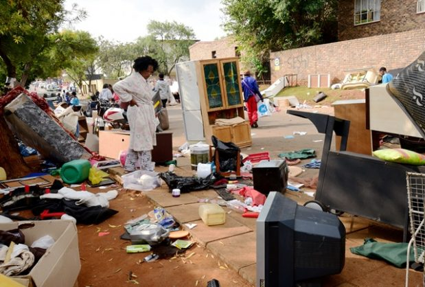 Windsor East residents with their belongings along Beatrice street in Randburg, north West of  Johannesburg, 16 April 2018, after a dispute between landlords and tenants. Red Ants evicted thousands of residents from the flats, which they allegedly occupied illegally. Picture: Nigel Sibanda