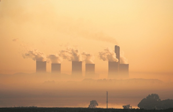 Steam rises at sunrise from the  Lethabo Power Station, a coal-fired power station owned by state power utility Eskom near Sasolburg, South Africa, March 2, 2016. Picture: Reuters