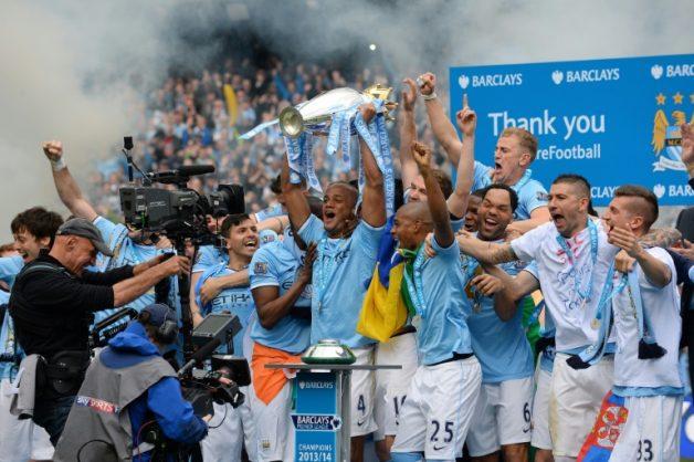 Same again: Vincent Kompany lifts the Premier League trophy in 2014
