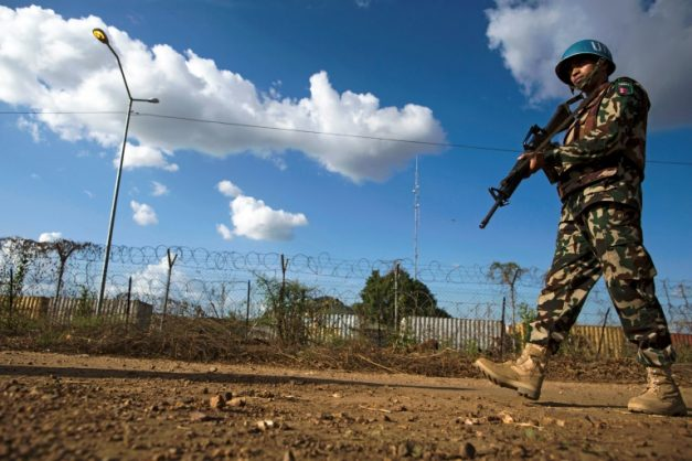 A Nepalese peacekeeper patrols outside the UN Protection of Civilians (PoC) site in Juba, South Sudan