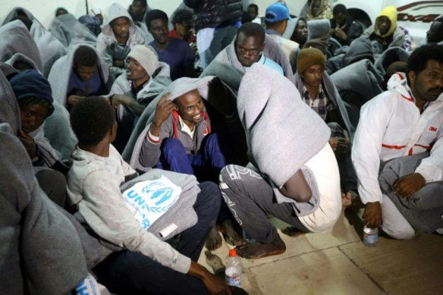 Migrants gather at a naval base in Tripoli on March 31, 2018, after they were rescued off Libya's coast