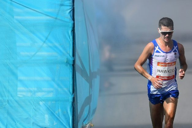 Scotland's Callum Hawkins collapsed just two kilometres (just over a mile) from victory.