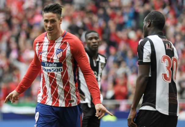 On target: Atletico Madrid's Fernando Torres celebrates his goal in the 3-0 win over Levante