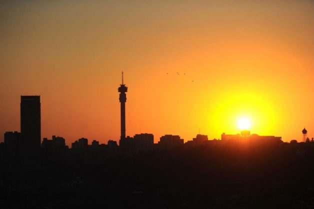 The sun sets over Johannesburg, with the Hillbrow Tower and the Ponte Tower clearly visible in the city skyline, 6 August 2015, as seen from the east of the city, as the highveld seasons change from winter to autumn. Picture: Michel Bega