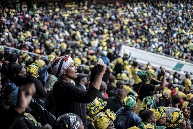Mourners sing at the memorial service for Winnie Madikizela Mandela at Orlando Stadium