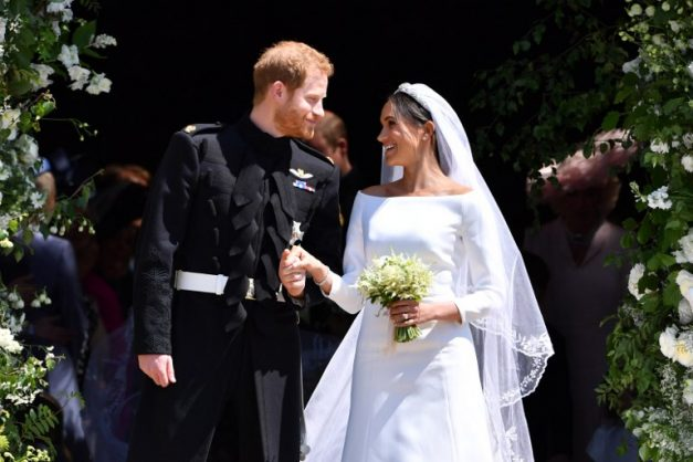 Britain's Prince Harry, Duke of Sussex and his wife Meghan, Duchess of Sussex emerge from the West Door of St George's Chapel, Windsor Castle, in Windsor, on May 19, 2018 after their wedding ceremony. / Picture: AFP PHOTO