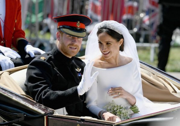Britain's Prince Harry, Duke of Sussex and his wife Meghan, Duchess of Sussex wave from the Ascot landau carriage during their carriage procession on the Long Walk as they head back towards Windsor Castle in Windsor, on May 19, 2018 after their wedding ceremony.  Picture: AFP PHOTO