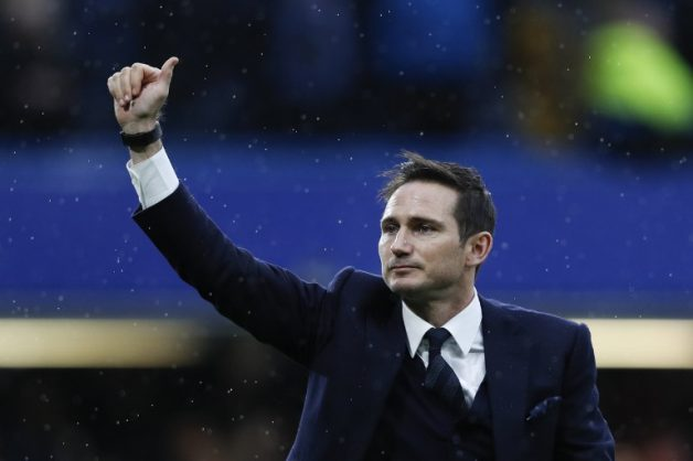 Frank Lampard gestures to the fans on the pitch at Stamford Bridge in London. Derby County have appointed ex-Chelsea and England midfielder Frank Lampard as their new manager on a three-year deal on May 31, 2018. / AFP PHOTO / Adrian DENNIS /