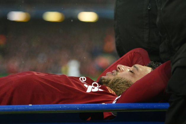 Liverpool's midfielder Alex Oxlade-Chamberlain is stretchered off the pitch during the UEFA Champions League first leg semi-final football match against Roma at Anfield stadium in Liverpool, north west England on April 24, 2018. AFP/File/Oli SCARFF