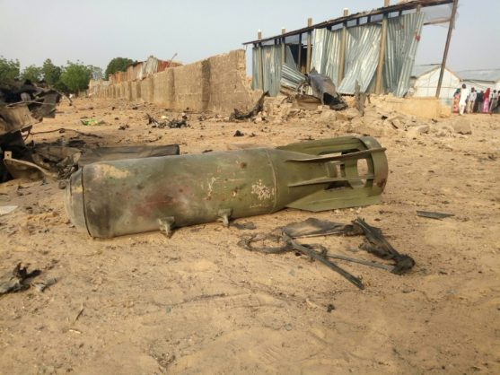 A bomb from an air strike by the Nigerian airforce lies on the ground after cross fire between the military and Boko Haram Islamists in Maiduguri, in April 2018. AFP/File/AUDU MARTE