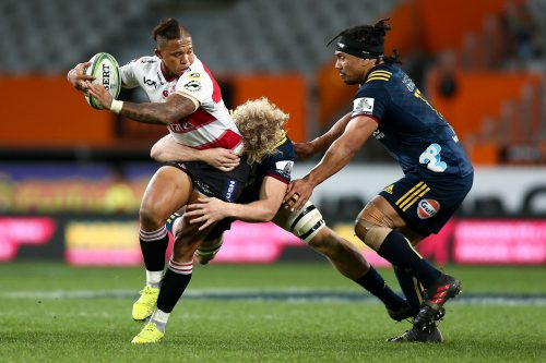 Elton Jantjies of the Lions is tackled during the round 12 Super Rugby match between the Highlanders and the Lions at Forsyth Barr Stadium on May 12, 2018 in Dunedin, New Zealand.  (Photo by Hagen Hopkins/Getty Images)