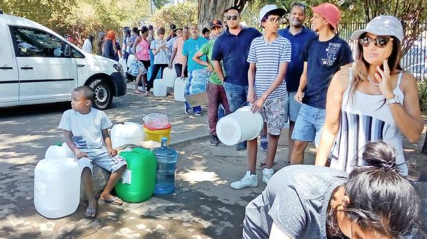Captetonians queue at the Newlands spring for water. Picture: ANA