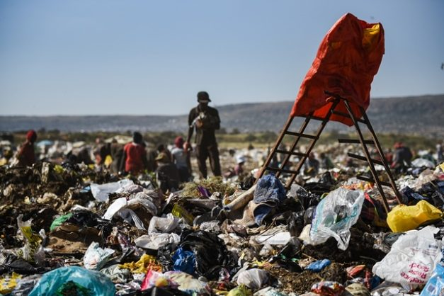 A red jacket is seen propped up over a colourful blanket covering the body of a newborn baby that was discovered among the trash at the Hatherley Municipal Dumping Site, 8 May 2018 in Mamelodi, Pretoria. Picture: Jacques Nelles