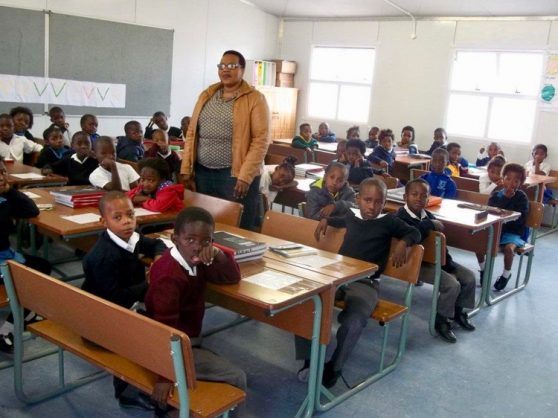 There are 51 children (not all are visible in the photo) in this class at Ekanini Primary in Khayelitsha. Grade 1 teacher Nozuko Nkunkuma is standing in the centre. Photo: Vincent Lali