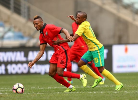 Thulani Serero battles Toni Brito Silva Sa during the International friendly match between South Africa and Guinea-Bissau at Moses Mabhida Stadium on March 25, 2017 in Durban, South Africa. (Photo by Anesh Debiky/Gallo Images)