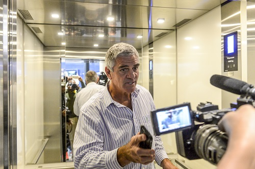 Nick Mallett enters the elevator after walking into the pause area from a meeting dealing with an on-air situation involving him and Naas Botha in which Ashwin Willemse walked out of the studio during live commentary. (Photo by Sydney Seshibedi/Gallo Images)