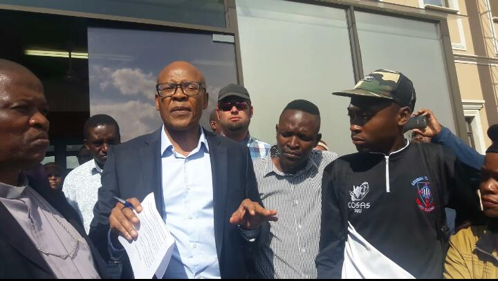 Mzwandile Manyi receives a memorandum of demands from the protesters at the Afro WorldView offices in Midrand, 3 May 2018. Picture: ANA