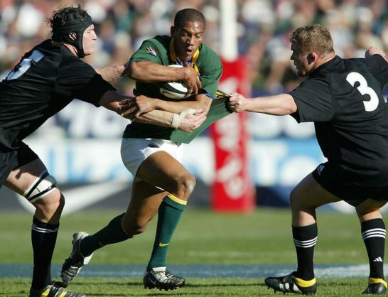 South African rugby player Ashwin Willemse (in green jersey) playing against New Zealand's All Blacks in 2003. Kim Ludbrook/EPA