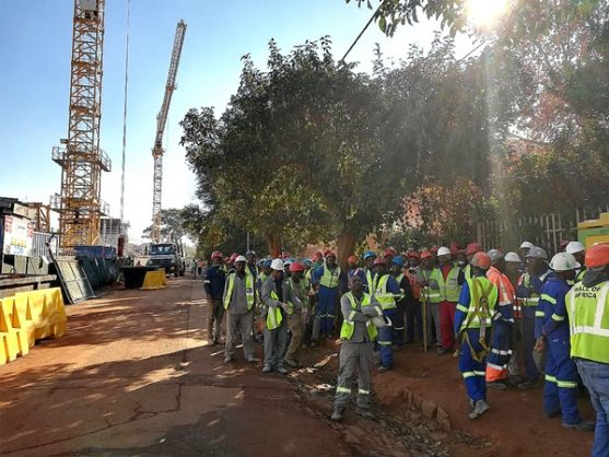 Workers at the site of a building operation in Auckland Park after City of Joburg inspectors arrived and ordered that all work be stopped, failing which the workers would be arrested, 30 May 2018. Picture: Facebook
