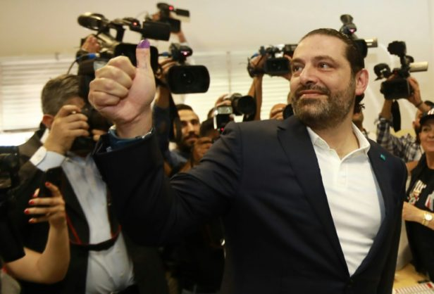 Lebanese Prime Minister Saad Hariri gives a thumbs-up with his ink-stained thumb after voting in Beirut on May 6, 2018